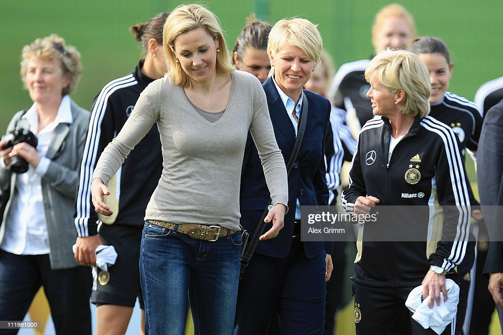 Bettina Wulff wife of German President Christian Wulff chats with team manager Doris Fitschen and head coach Silvia Neid during a visit at the...
