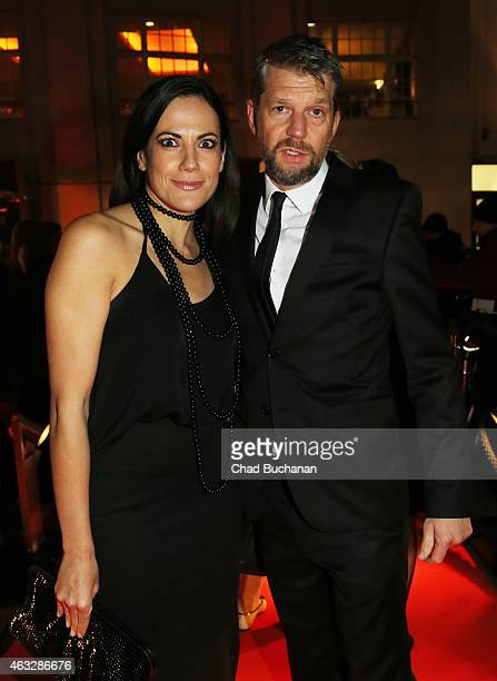 Bettina Zimmermann and Kai Wiesinger attend the 99Fire Film Awards during the 65th Berlinale International Film Festival at Admiralspalast on...