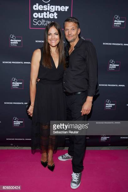 Bettina Zimmermann and Kai Wiesinger attend the late night shopping at Designer Outlet Soltau on August 4 2017 in Soltau Germany