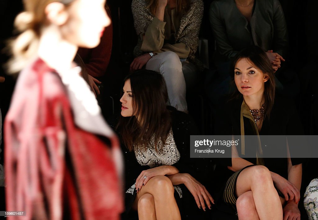 Bettina Zimmermann and Nadine Warmuth attend Schumacher Autumn/Winter 2013/14 Fashion Show during Mercedes-Benz Fashion Week Berlin at Brandenburg Gate on January 17, 2013 in Berlin, Germany. on January 17, 2013 in Berlin, Germany.