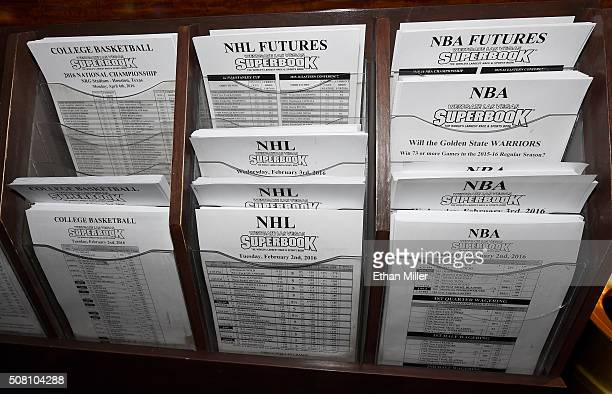 Betting sheets for NBA NHL and NCAA basketball are stacked at the Race Sports SuperBook at the Westgate Las Vegas Resort Casino on February 2 2016 in...