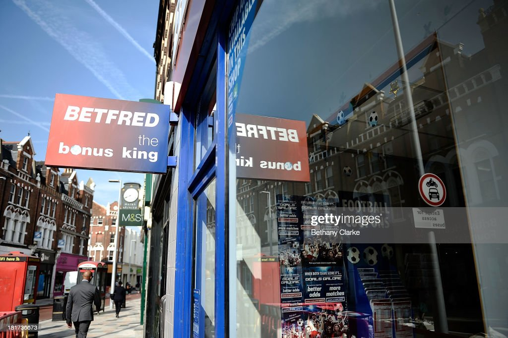 A Betting shop on St Johns Road Clapham on September 24, 2013 in London, England. The Labour leader Ed Miliband in his party conference speech has pledged to help small firms by freezing business rates in England. The high street has becoming increasingly full of betting shops, charity shops and pawn brokers replacing independent shops.