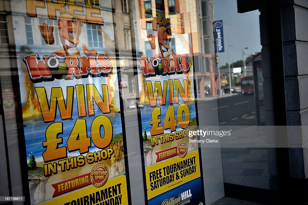 A Betting shop window on St Johns Road Clapham on September 24, 2013 in London, England. The Labour leader Ed Miliband in his party conference speech has pledged to help small firms by freezing business rates in England. The high street has becoming increasingly full of betting shops, charity shops and pawn brokers replacing independent shops.