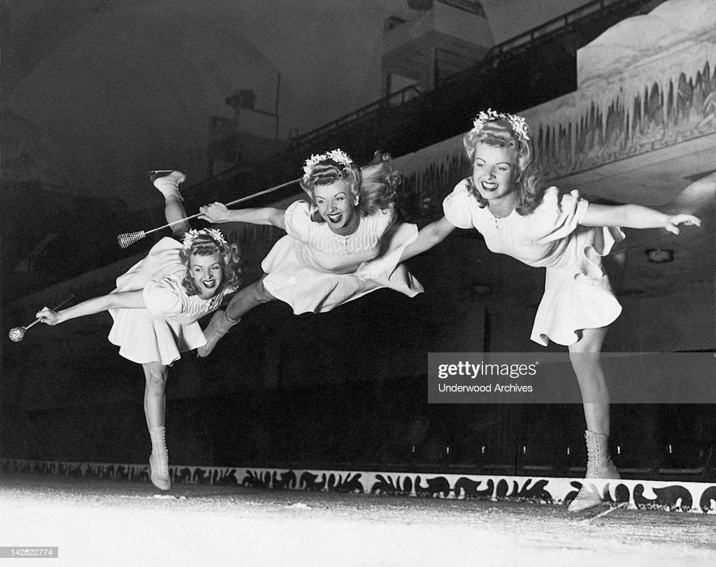 Betty Atkinson, Ice Follies skater, does an Arabian Cartwheel that is caught in a triple exposure by the photographer at Winterland, San Francisco, California, August 1942.