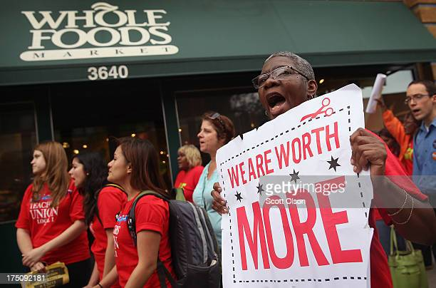 Betty Bailey of SEIU Local 1 protests with Whole Foods Market employees and other union activists outside a Whole Foods Market store on July 31 2013...