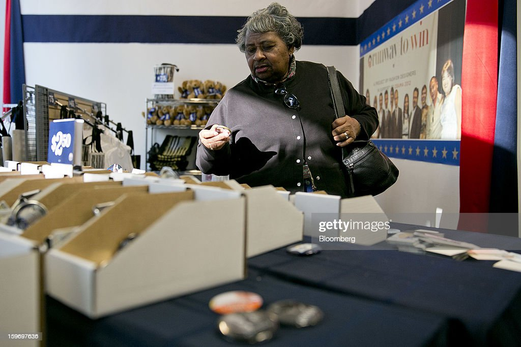 Betty Boseman looks though buttons at the Presidential Inaugural Committee store in Washington, D.C., U.S., on Friday, Jan. 18, 2013. President Barack Obama's second inauguration next week will combine the star power of Beyonce, Kelly Clarkson and James Taylor with a lineup that reflects social values Obama will champion in his new term. Photographer: Andrew Harrer/Bloomberg via Getty Images