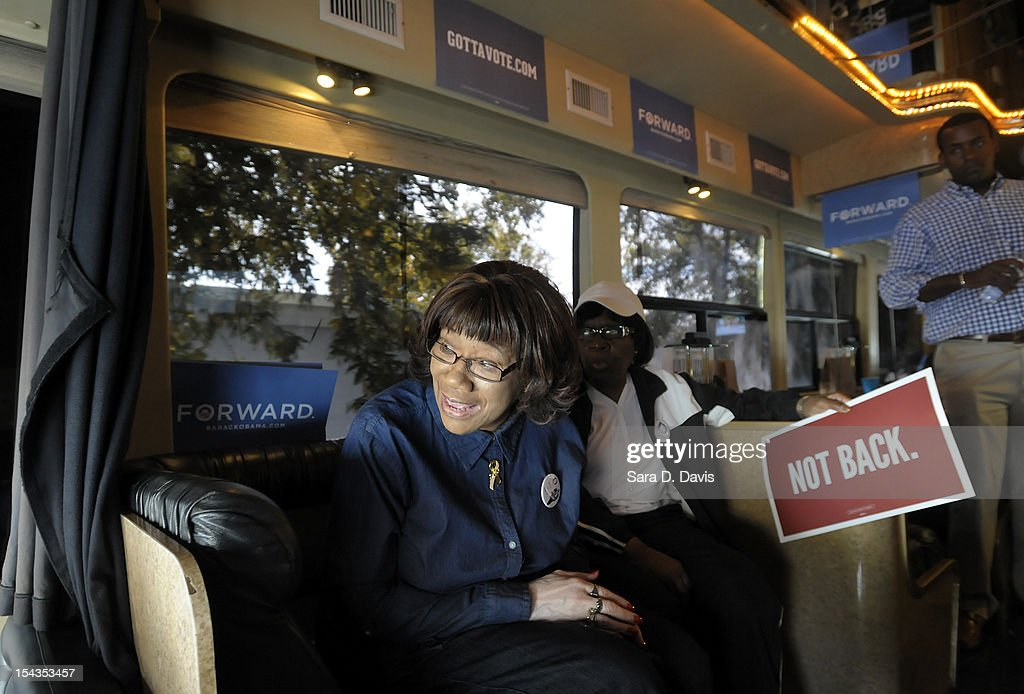 Betty Boykins, 57 of Wilson, peers out the front of the Democratic National Committee and Obama for America ÒGotta VoteÓ Bus as the bus pulls into to a polling precinct for the first day of early voting on October 18, 2012 in Wilson, North Carolina. The DNC/OFA Bus is on a month long tour spending through the end of the week in North Carolina. Today is the first day to vote for the election in North Carolina. Early voting is offered at select location from now through November 3.