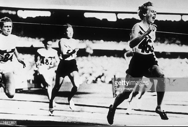 Betty Cuthbert of Australia wins the 200m beating Christa Stubnik of Germany and Marlene Mathews of Australia during the Olympic Games in Melbourne...