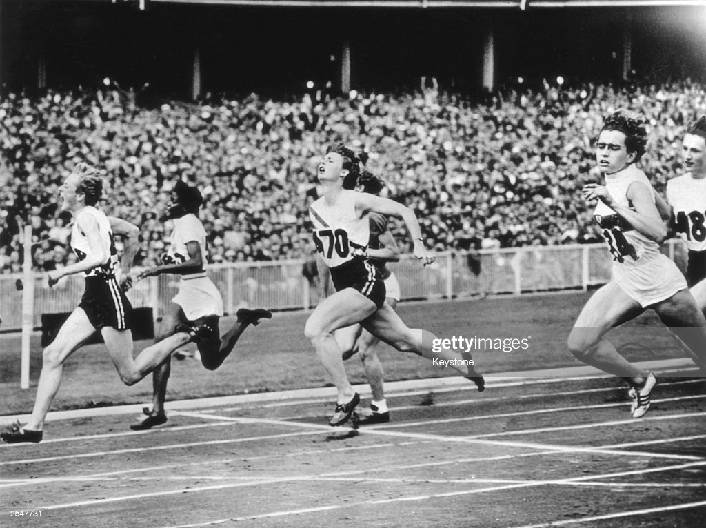 Betty Cuthbert of Australia (No.468) wins the women's 100 metres final at the Melbourne Olympics, 2nd December 1956.