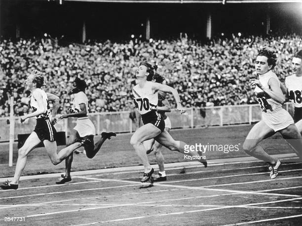 Betty Cuthbert of Australia wins the women's 100 metres final at the Melbourne Olympics 2nd December 1956