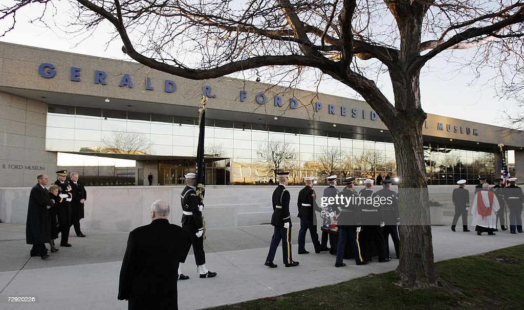 Betty Ford her son Steven and Maj Gen Guy Swan III follow former President Gerald R Ford's casket past the Gerald R Ford Presidential Museum on it's...