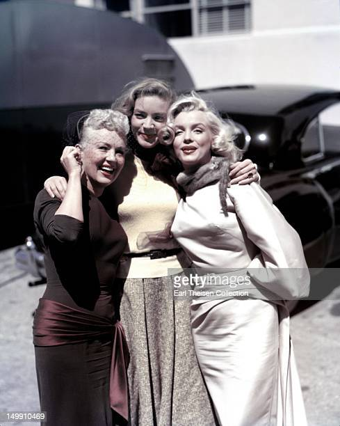 Betty Grable Lauren Bacall and Marilyn Monroe pose for a portrait on the set of the 20th CenturyFox film 'How to Marry a Millionaire' in 1953 in Los...