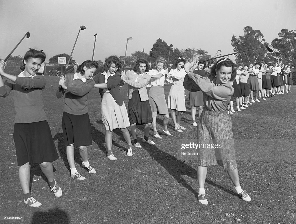 Betty Hicks Newell, 21 year old woman's national golf championship selected as America's outstanding woman athlete, is shown teaching a class of high coeds, in the art of the links game. Betty was working as an apprentice under George Lake, local Pro in order to qualify under PGA ruling, to become America's first full fledged woman pro.