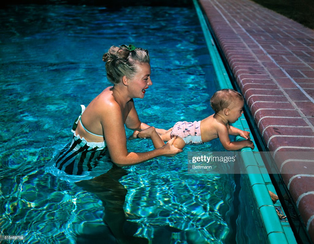 Betty Hutton and daughter Lindsay Diane Briskin 9monthsold is pictured in swimming pool