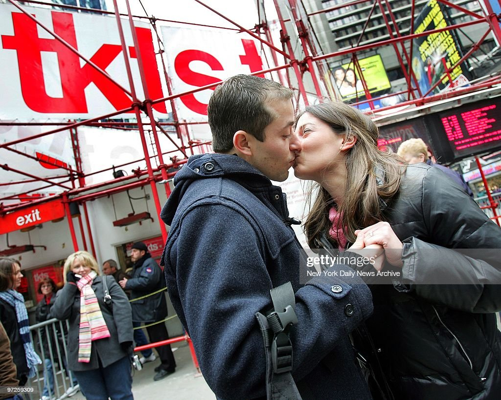Betty Levy gives a kiss to new fianc? Aaron Winnick after accepting his proposal in Times Square. Winnick had his question flash across the bottom of the TKTS marquee: 'Betty Levy, will you marry me? Aaron,' after which he dropped to one knee and produced a stunning diamond ring. '[Buying tickets] will never be the same here, I'll tell you that!' said Levy.