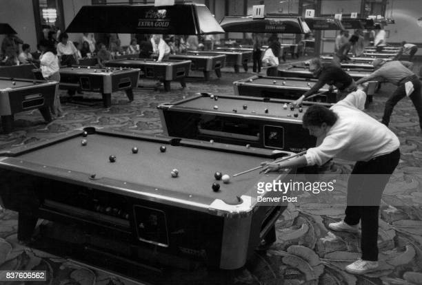 Betty Maguire of Pittsburgh lines up a shot during individual competition at the Billiard Congress of America National 8Ball tournament at the...