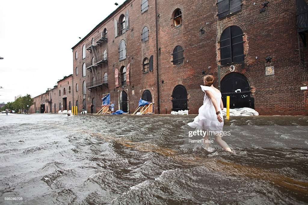 Betty Walsh walks through a flooded street in Red Hook section of Brooklyn after hurricane Irene made landfall in New York City on Sunday August 28...