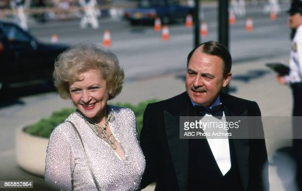 Betty White and John Hillerman arrive at The 37th Primetime Emmy Awards on September22 1985 at Pasadena Civic Auditorium Pasadena California