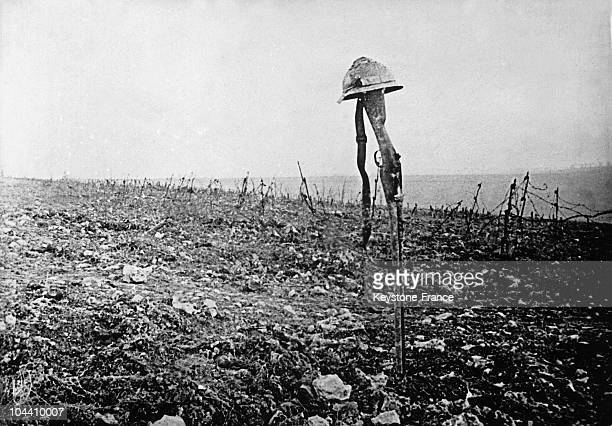Between 1916 and 1918 a view of this rifle and helmet which mark the tomb of a French soldier who fell at in the front lines during the battle of...