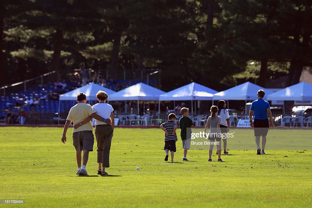 Between chukkas, fans replace the divits on the field during the game between Team Mercedes and the Caballeros Polo Team in Bethpage State Park on September 9, 2012 in Bethpage, New York.