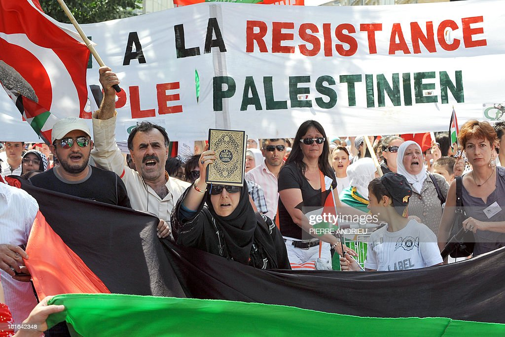 Between five hundred and one thousand people protest with a Palestinian flag on June 5, 2010 in Bordeaux, southern France, during a demonstration to protest against Israeli's storming of a Gaza-bound aid flotilla that left nine pro-Palestinian activits dead. Banner reads 'Support to Palestinian people's resistance'.