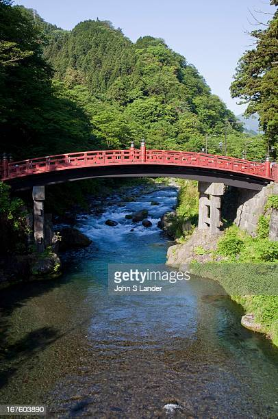 Between Nikko and its main shrines is the Shinkyo Bridge a red lacquered span that arches gracefully across the Daiya River Legend has it that a...