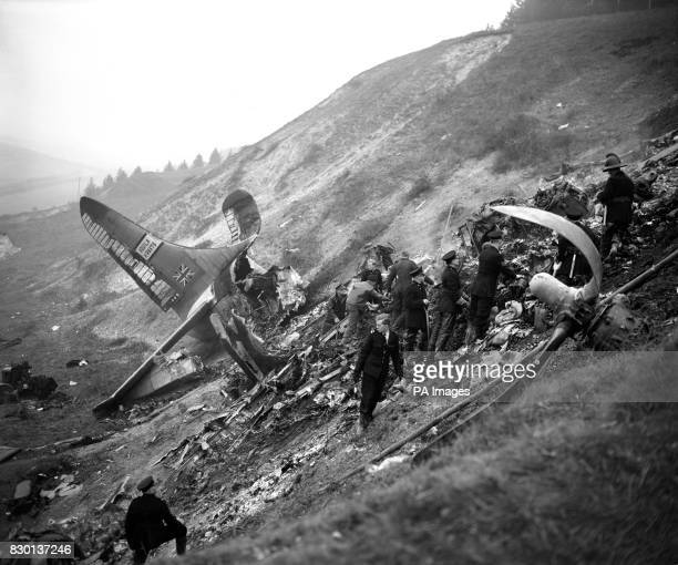 Between the severed tail unit and a twisted propeller searchers hunt for bodies amid the wreckage of the Aquila Airways double deck flying boat that...