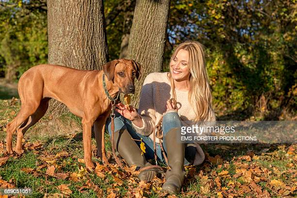 beuty woman with her dog in nice sunlight