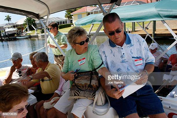 Bev Koppang and Chuck Koppang along with other prospective buyers take part in a foreclosure boat tour by Foreclosures 'R Us realty company on March...