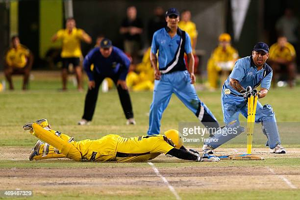 Bevan Bennell of Western Australia slides to score the winning runs during the Imparja Cup Final between Western Australia and New South Wales at...