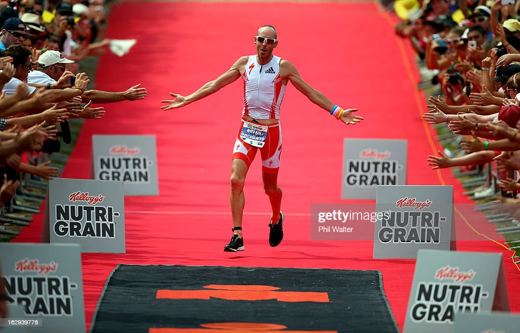 Bevan Docherty of New Zealand celebrates winning the New Zealand Ironman on March 2, 2013 in Taupo, New Zealand.