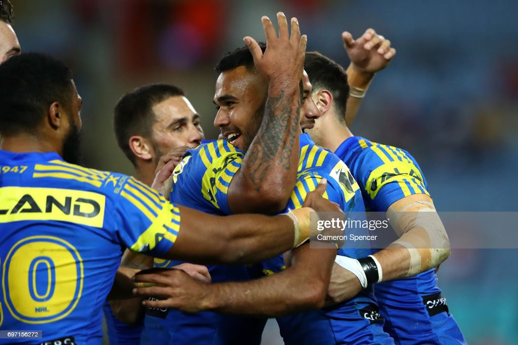 Bevan French of the Eels celebrates scoring a try with team mates during the round 15 NRL match between the Parramatta Eels and the St George Illawarra Dragons at ANZ Stadium on June 18, 2017 in Sydney, Australia.