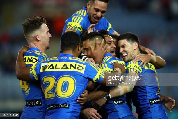 Bevan French of the Eels celebrates scoring a try with team mates during the round 15 NRL match between the Parramatta Eels and the St George...