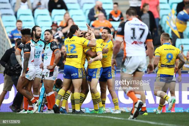 Bevan French of the Eels celebrates with team mates after scoring a try during the round 20 NRL match between the Wests Tigers and the Parramatta...