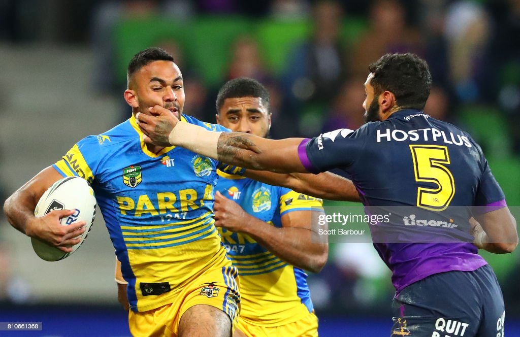 Bevan French of the Eels is tackled by Josh Addo-Carr of the Storm during the round 18 NRL match between the Melbourne Storm and the Parramatta Eels at AAMI Park on July 8, 2017 in Melbourne, Australia.