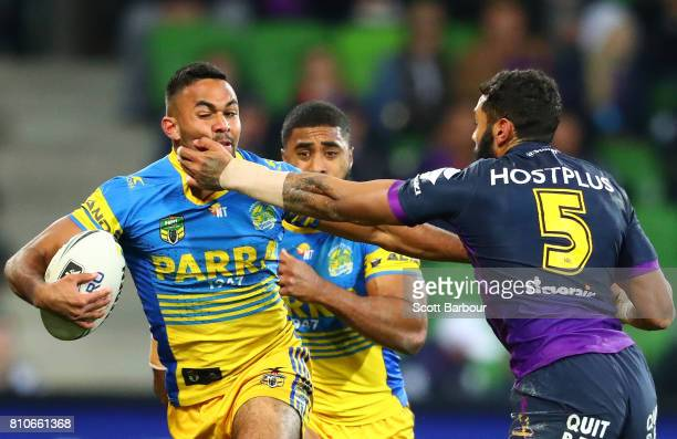 Bevan French of the Eels is tackled by Josh AddoCarr of the Storm during the round 18 NRL match between the Melbourne Storm and the Parramatta Eels...