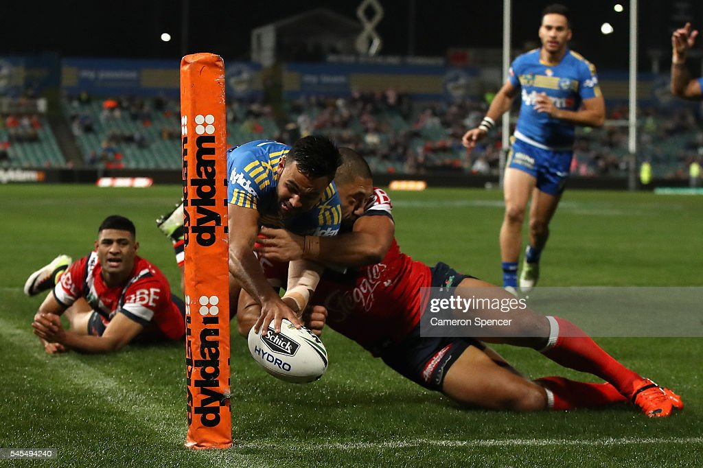 Bevan French of the Eels is tackled over the sideline as he attempts to score a try during the round 18 NRL match between the Parramatta Eels and the Sydney Roosters at Pirtek Stadium on July 8, 2016 in Sydney, Australia.