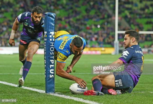 Bevan French of the Eels scores the first try during the round 18 NRL match between the Melbourne Storm and the Parramatta Eels at AAMI Park on July...