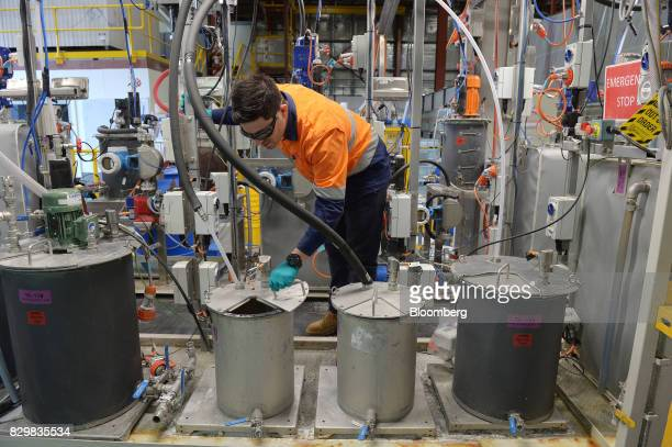 Bevan Xiberras metallurgical engineer at Rio Tinto Group inspects equipment inside the company's Bundoora Integrated Continuous Chemical Pilot Plant...