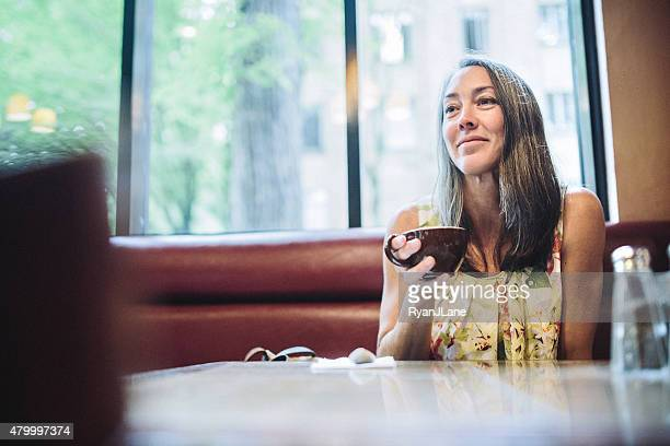 Beverage At Coffee Shop Mature Woman Drinking