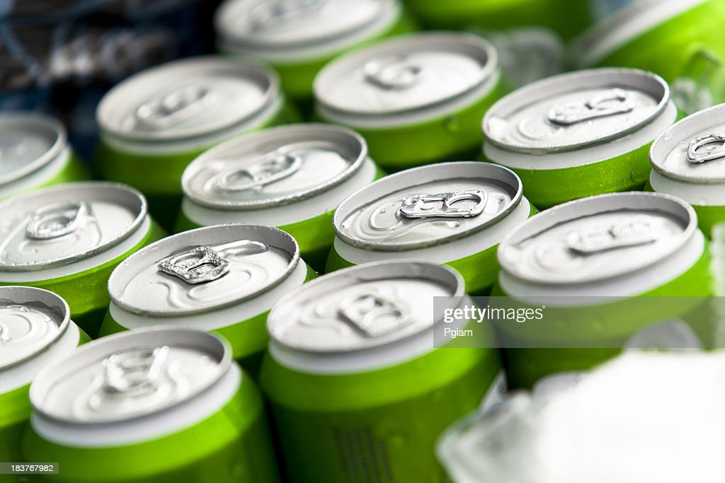Beverage cans on ice : Stock Photo