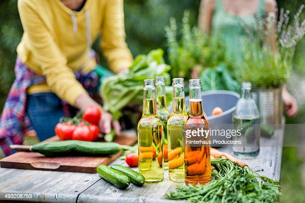 Beverages And Vegetable On Garden Table
