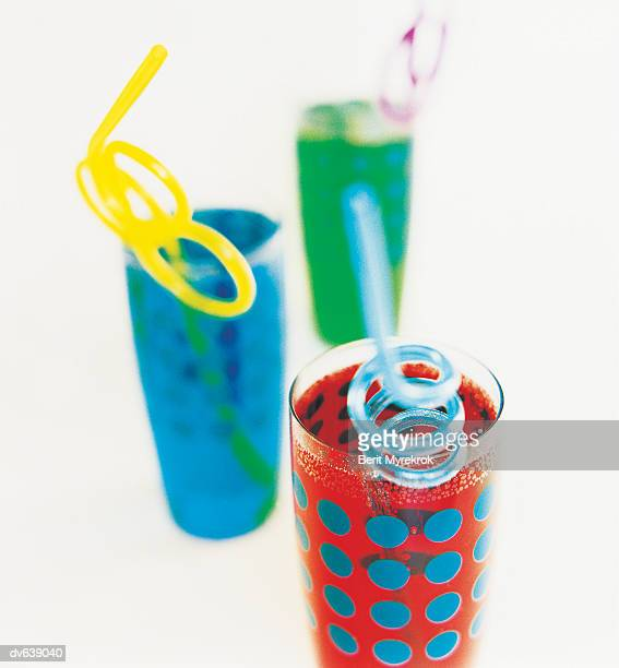 Beverages with Shaped Drinking Straws