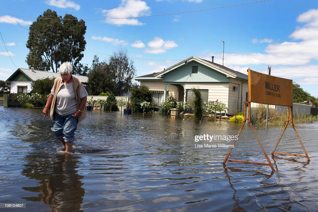 Beverley McTaggart returns to inspect flood damage at her family home on January 18, 2011 in Horsham, Australia. Residents and emergency crews sandbagged properties and evacuations have been ordered in the town experiencing the worst flooding in over 200 years. A relief centre has been set-up in at Horsham Town Hall and emergency crews are on-site as the Wimmera River water level reaches it's peak. The Victorian floods have so far claimed one life, with the body of a missing seven-year-old boy believed to be found earlier today.