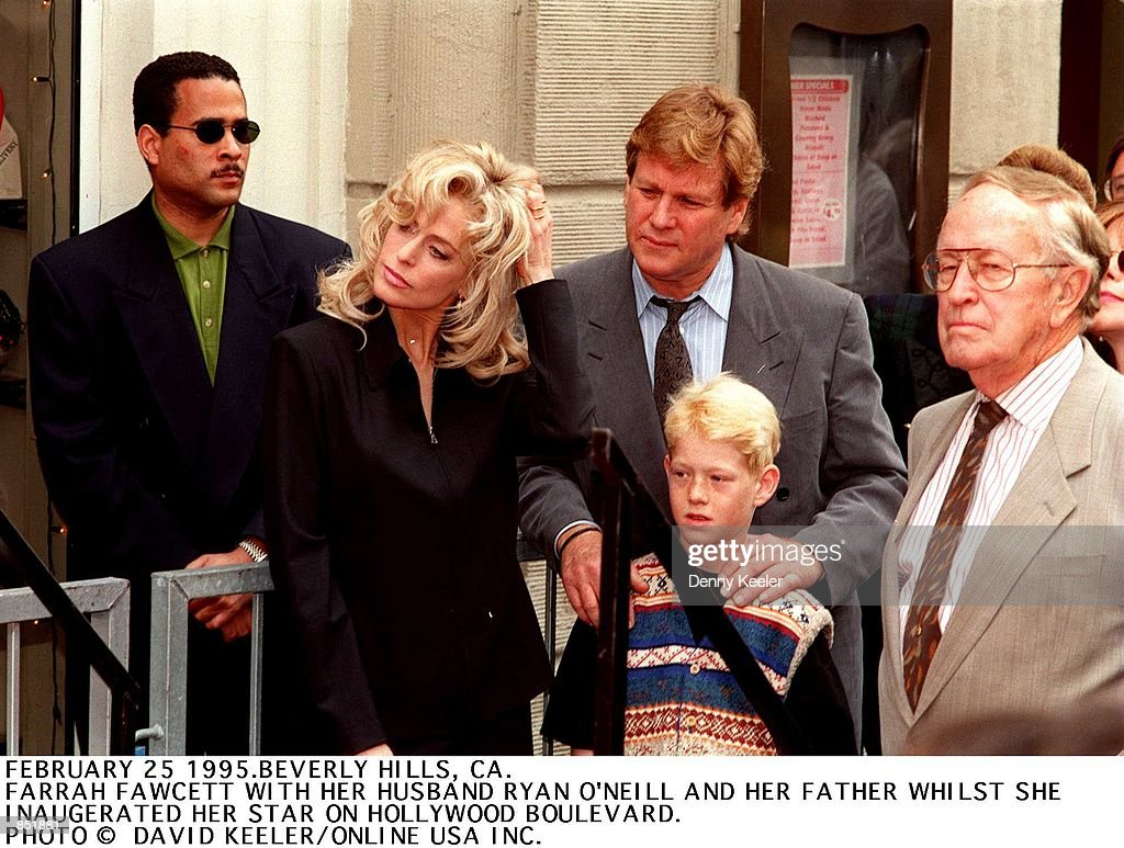 Beverly Hills CA Farrah Fawcett with Ryan O''Neal and their son Redmond on Hollywood Boulevard where she received her star