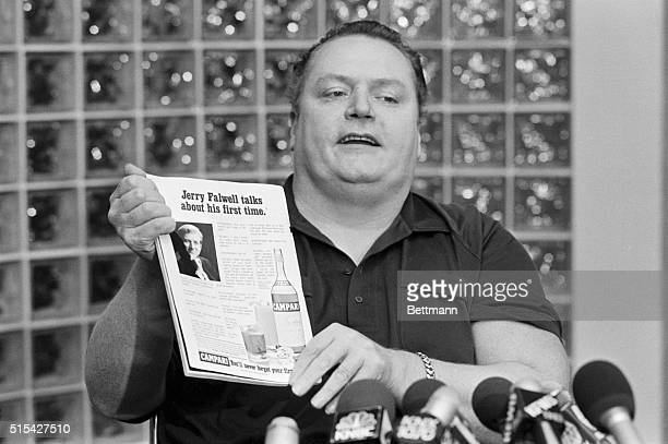 Beverly Hills California Hustler magazine publisher Larry Flynt speaking to reporters at a press conference 2/24 holds up a copy of the ad parody...