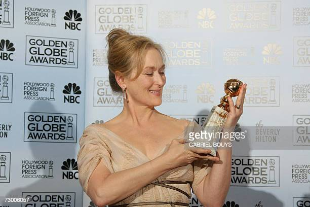 Meryl Streep poses with the award 15 January 2007 at the 64th Annual Golden Globe Awards in Beverly Hills California Streep won Best Performance by...