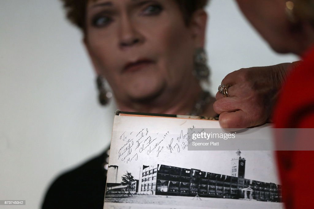 Beverly Young Nelson holds her high school yearbook signed by Roy Moore during a news conference where she has accused Alabama Republican Senate candidate Roy Moore of sexually abusing her when she was 16 on November 13, 2017 in New York City. Moore, a controversial politician who recently won a run-off against Luther Strange for Alabama's Senate seat, is currently fighting accusations alleging that he pursued sexual relationships with teenagers -- including a 14-year-old -- when he was in his 30s.
