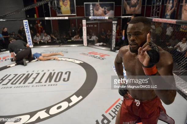 Bevon Lewis celebrates after defeating Elias Urbina in their middleweight bout during Dana White's Tuesday Night Contender Series at the TUF Gym on...