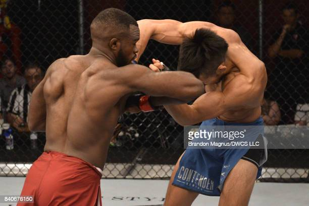 Bevon Lewis lands an elbow against Elias Urbina in their middleweight bout during Dana White's Tuesday Night Contender Series at the TUF Gym on...